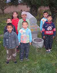 Fig. 2 Sixth-generation descendents of the shaykh of the Jahriyya sufi order and Muslim uprising leader Ma Hualong, in the garden of the Nanchuan Jahriyya tomb complex, Zhangjiachuan, Gansu. [AHG]